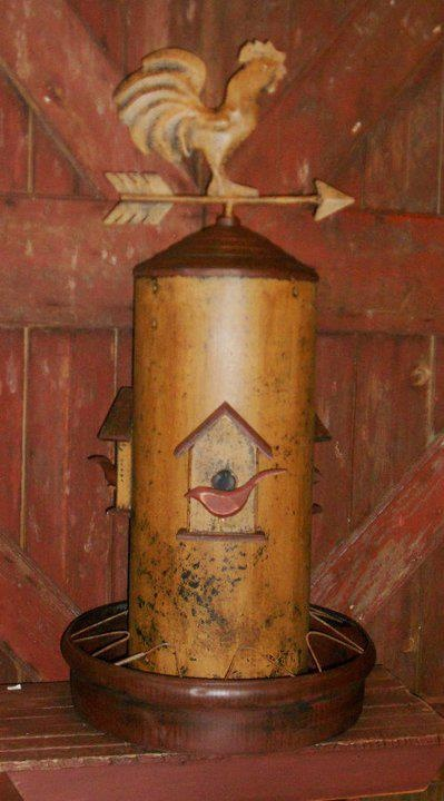 old chicken feeder turned into birdhouse.  I love this!