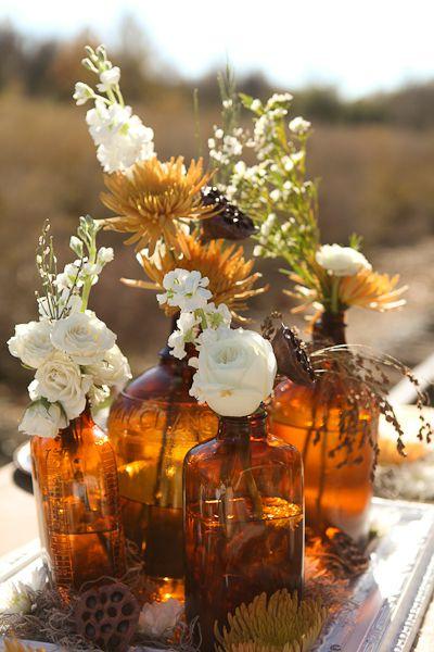 Fresh flowers in vintage apothecary bottles ~ lovely autumn arrangement