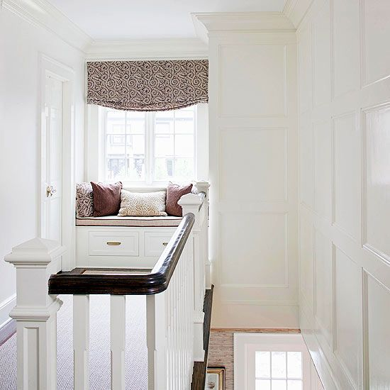 A tucked-away window seat makes for a cozy reading nook. Tour the rest of this restored home: www.bhg.com/...