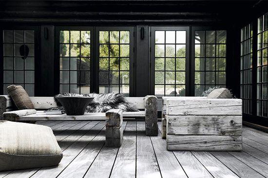 I love the light wood flooring against the black.