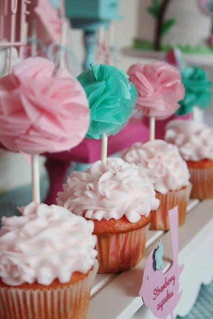 Pom poms for cupcake decorations to match the bakery party decor! cute!