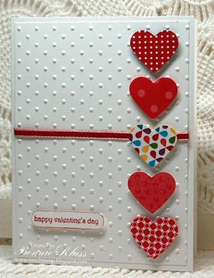 handmade Valentine card ... column of punched hearts ... embossing folder dot pattern for background layer...