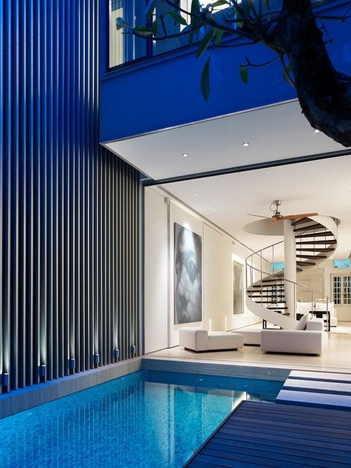 My eyes went wild when I saw this photo! It truly is a dream apartment with the spiral stair case and pool area!