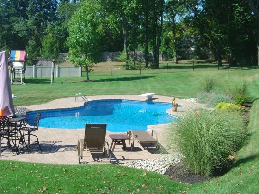 Poolside Landscaping - Home and Garden Design Idea's