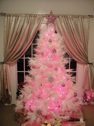 A white Christmas tree with pink lights.