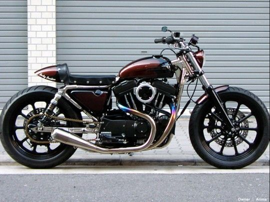 Tramp Cycles has revolutionized the look of the XLH1200S—turning it into a very sleek and low cafe racer.