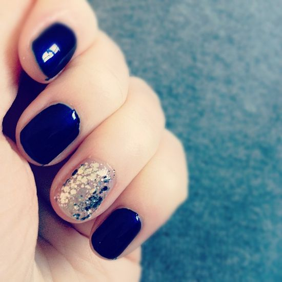 navy + silver glitter accent nails.