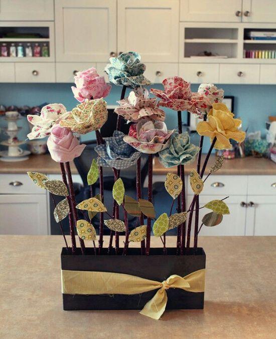 Handmade roses in flowerbed