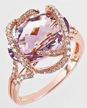 A pink diamond framed with rose gold