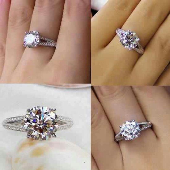 Take away the small diamonds on the band, and you have the most perfect simple engagement ring.