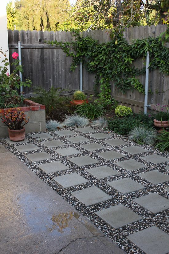 Square pavers with rock against existing slab