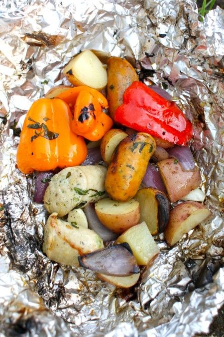 Peppers, onions and sausage in foil.