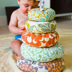 Make a stacking ring toy for baby in fabrics you choose.  The perfect baby shower gift that will have all the guests ooh-ing and aah-ing.