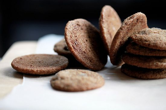 [Cookies] ---- Chewy Ginger Chocolate Cookies:: 2 1/4 c all-purpose flour, 2 tsp baking soda, 1/4 tsp salt, 1 tsp ground cinnamon, 1 tsp ground ginger, 1/2 tsp ground cloves, 3/4 c softened unsalted butter, 1 c brown sugar, 1 large egg, 1/4 c molasses, 1/2 c chocolate chips, 1/4 c granulated sugar for rolling dough balls. ---- Make 4 dozen.