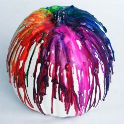 Start your Halloween decorating off with a bang with this colorful crayon drip canvas!