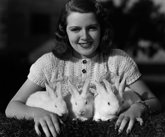 A young Lana Turner poses with a quartet of adorable bunnies during the late 1930s
