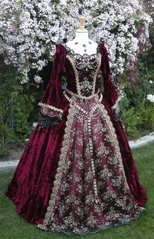 Renaissance Wine Velvet Fantasy Gown (romanticthreads.com)  This dress from the renaissance period caught my eye, the deep wine red colour is so beautiful and contrasts well against the detailed embroidery. This shouts class and elegance. Very beautiful, intricate garment.