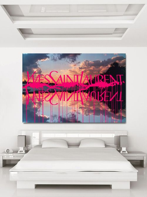 all white bedroom with a pop of art