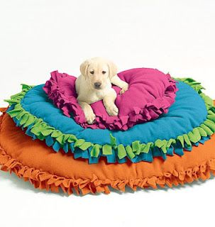 Frugal Pet Tip: No Sew Pet Bed    -- This pet bed looks pretty simple to make and needs no sewing at all! Probably much cheaper than buying one, and you can wash it!    Making a fleece pet bed yourself allows you to fully customize the pet bed, and choose the cover, filling and style that suits you, and your dog or cat, best! Photo credit: McCall's