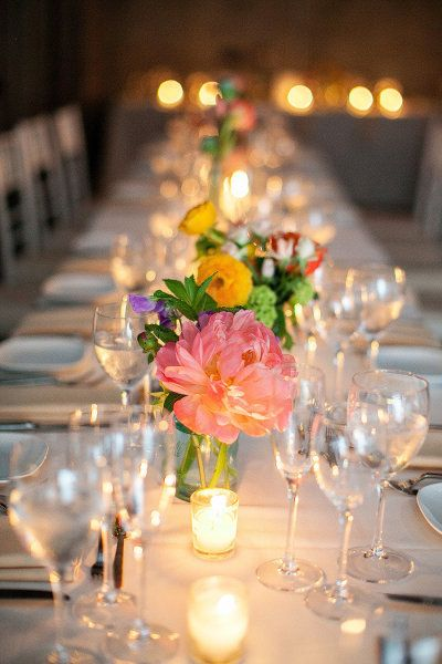 bright floral centerpieces at an all white reception