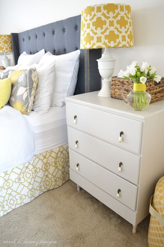 Instead of grey, we have plum purple! love this!! (Gray, Yellow and White Bedroom with gray upholstered headboard, yellow trellis bedskirt and lamps and painted nightstands - Sarah M Dorsey Designs)