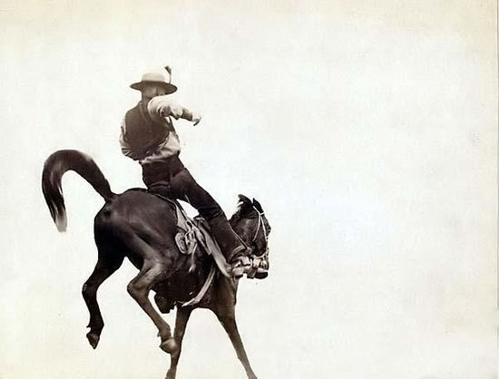"Here for your consideration is an artistic picture of ""Bucking Bronco."" Ned Coy, a famous Dakota cowboy, starts out for the cattle round-up with his pet ""Boy Dick"". It was created in 1888 by Grabill, John C. H., photographer."