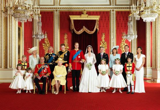 The royal family poses for the official royal wedding portrait taken in the Throne Room at Buckingham Palace in London on April 29, 2011. Groom Prince William and bride Kate Middleton stand front and center.