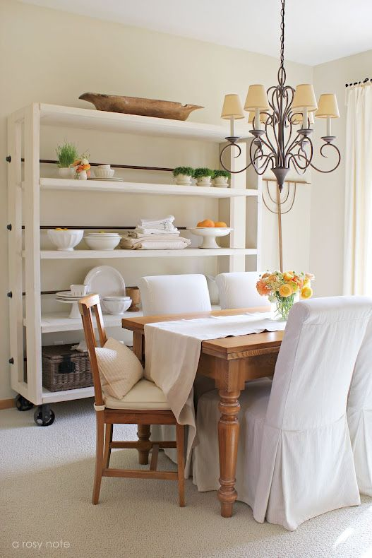 gorgeous restoration styled shelving unit (wood and metal tubing) by A Rosy Note