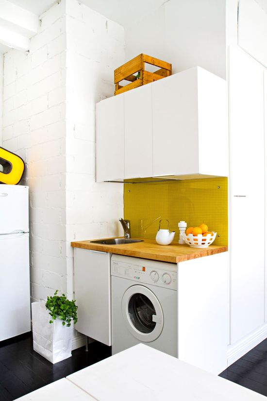 Love this small kitchen with yellow details