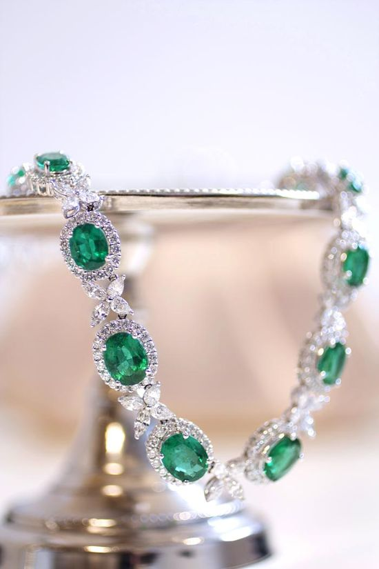 Refined elegance meets scintillating glamour in this 18k white gold statement necklace that showcases more than 38 carats of vibrant green emeralds and over 16 carats of shimmering diamonds. #bluenile