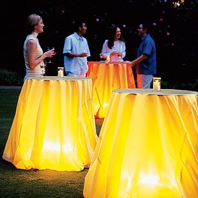 Create a nice ambience for a patio party by putting battery-operated lanterns under tablecloths.