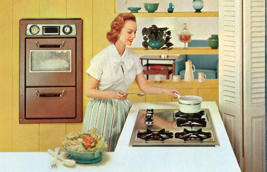 Great mid-century kitchen and a cute bow blouse to boot! #vintage #homemaker #1950s #kitchen