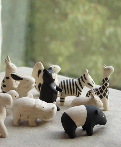hand carved wooden animals. cute!