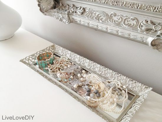 Spray paint titanium silver on a thrift store gold tray. Makes for a great place to toss your jewelry!