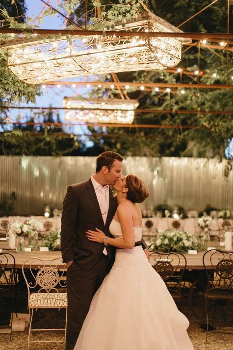 A romantic bride & groom kiss at their reception // Modern Love Photography