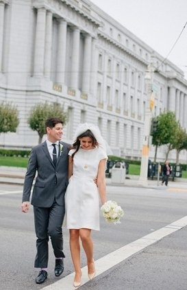 We love the simple, short dress paired with pointy-toe flats; this city hall bride nails it.