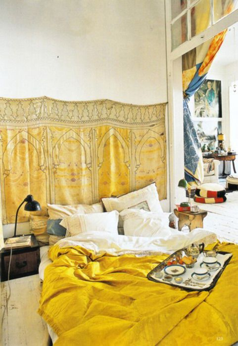 I am so in love with this room. The mustard and the dirty white with the soft textures and the cloth headboard. All of it, yes. SO much yes. I want so badly to drink tea and read books in this space.