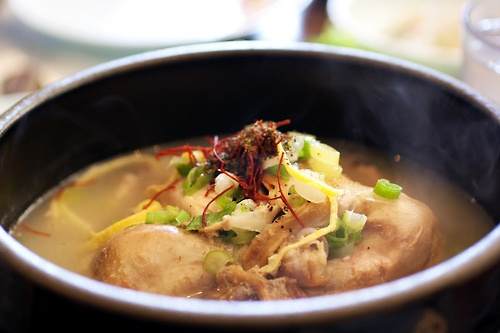 """Samgyetang primarily consists of a whole young chickenand Korean ginseng. The dish's name literally translates as """"'ginseng chicken soup"""" in English. Samgyetang is traditionally served in the summer for its supposed nutrients, which replaces those lost through excessive sweating and physical exertion during the hot summers in Korea."""