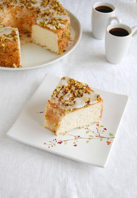 Lemon angel food cake with lemon glaze and pistachios