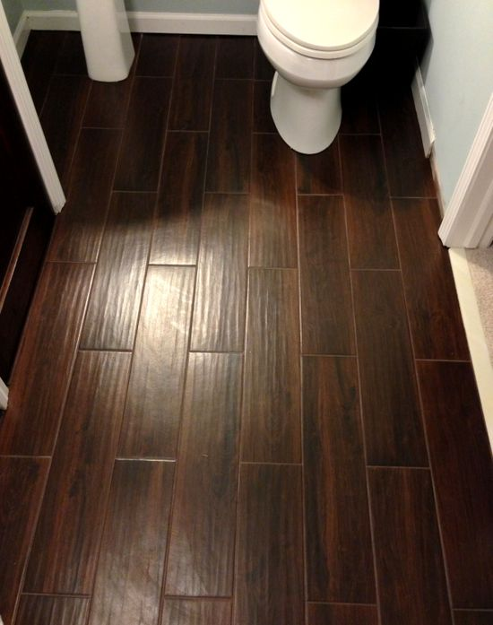 Tile that looks like wood. Tile sold at Lowe's. Style Selections 6-in x 24-in Serso Mahogany Glazed Porcelain Floor Tile  Item #: 397694
