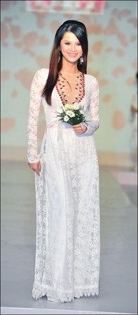 white dress with great details around neckline by Vietnamese designer Ao Dai.