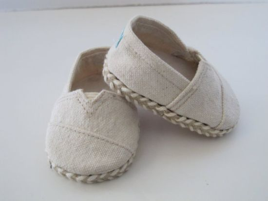 """One pair custom made """"janes"""" from Natural Cream Color Canvas. The shoes are lined with cream cotton, have cork soles, and are trimmed with woven braid. They were constructed using a liberty jane pattern, and I am a partner."""