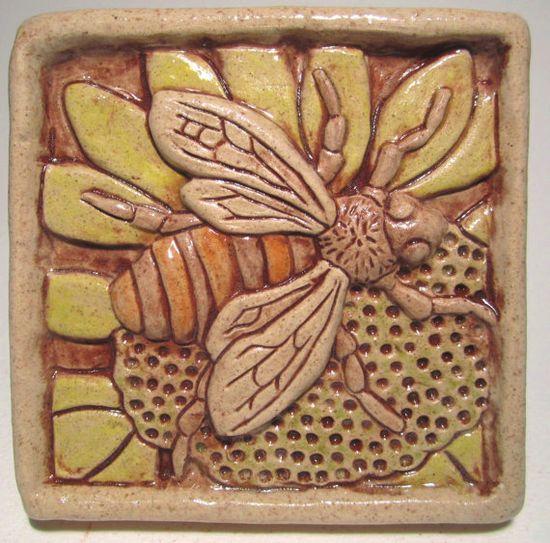 Ceramic bee tile.