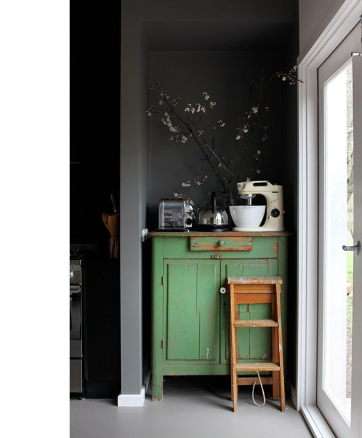 Lovely vintage green next to clean gray walls.