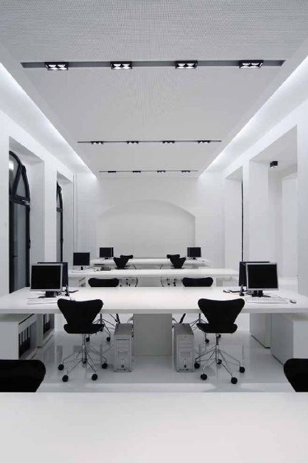 Another clean black and white office open space _
