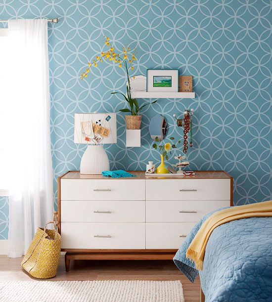Stencil a Wall~~Give one wall in a room a dose of pattern with a stencil. It's less time-consuming than stenciling a whole room, and you'll need less paint. For subtle contrast, use a color for the pattern that is just a few shades lighter than the background.