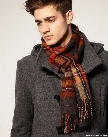 ? Man's casual fashion wear sport a scarf over open collar of a peacoat
