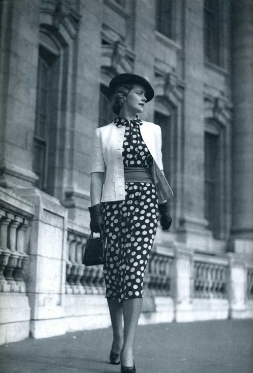 1930s Fashion: Polka-dot dress with light jacket.