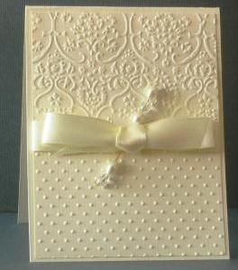 beautiful card, love the elegance of the all white (or is it vanilla?) card with the pearl and the touch of satin ribbon.