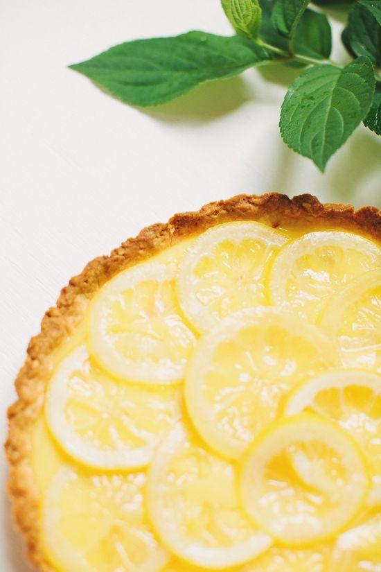 a lemon tart with candied lemons
